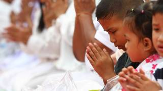 buddhist children in Laos praying