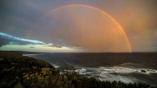 rainbow over the australian ocean