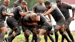 rugby players muddy