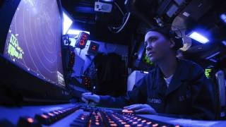sailor working on a ship computer screens
