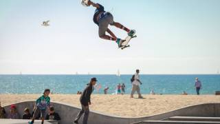 teens riding on skateboards by the beach