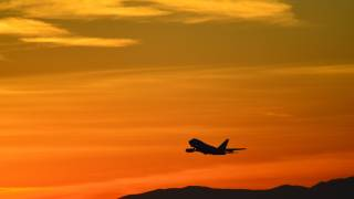 jet taking off into the sunset from China