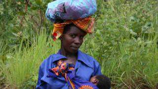 african woman with infant
