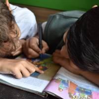 two youg boys studying