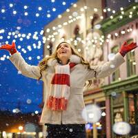 happy lady, lights in a winter scene