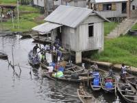 african village river with boats