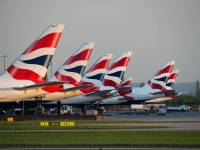tails of British airlines jets at an airport