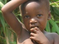 young african child in the woods