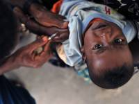 young child getting vaccine