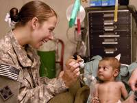medical doctor in the field taking care  of infant