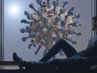 man sitting in a window, coronavirus outside